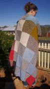 Mitred blanket of many colours